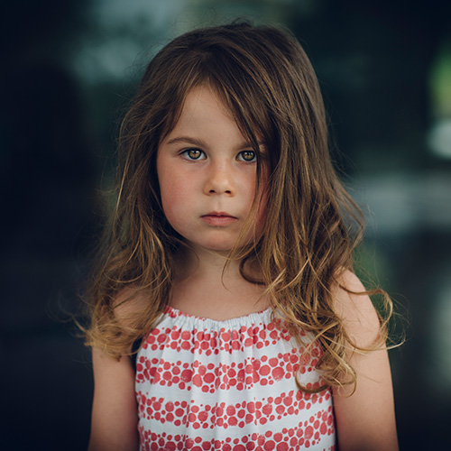 young girl looking very sad